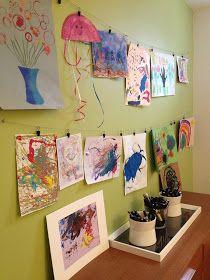 Easy, inexpensive, wall-saving way to hang kids art.  Twine  clothespins.