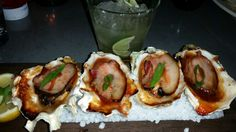 Oysters in a half shell with bacon and BBQ sauce