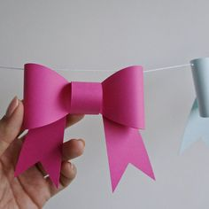 This sweet DIY garland with 3D bows would look cute at a baby shower, first birthday party, or as a nursery decoration. Each bow garland kit includes instructions, string and pre-cut pieces to make and assemble 12 or 24 bows. Just add glue! Twelve bows makes a 6 garland using the spacing seen in photos. A set of 12 bows can be assembled in 20 to 30 minutes.  Product details: - digitally cut for precise, clean edges - cut from lightweight (65lb) card stock - each bow is 4.7 x 3.8 once…