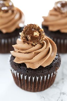 Ultimate Nutella Cupcakes feature my perfectly moist chocolate cupcake base which is filled with Nutella, topped with Nutella buttercream, and garnished with a Ferrero Rocher candy! It's Nutella perfection! | Handle the Heat