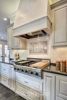 painted backsplash, painted cabinets with glaze and plaster/paint range hood, painted scene on tile.