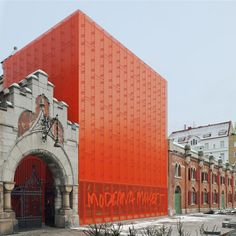 An extension clad in perforated orange metal was added to a museum in Malmö by Tham + Videgard Arkitekter.