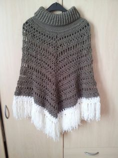 Crochet poncho with cowl neck. Free poncho pattern form http://www.ravelry.com/patterns/library/boho-poncho-2 . I did the cowl neck myself (got the inspiration for the neck http://attic24.typepad.com/weblog/2014/12/cowl-neck-poncho-ta-dah.html)