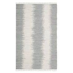 """Add a cosmopolitan touch to your living room seating group or master suite decor with this hand-woven cotton rug, showcasing a color-blocked motif for bold appeal.  Product: RugConstruction Material: CottonColor: GreyFeatures:  Hand-wovenMade in IndiaPile Height: 0.5"""" Note: Please be aware that actual colors may vary from those shown on your screen. Accent rugs may also not show the entire pattern that the corresponding area rugs have.Cleaning and Care: Professional cleaning recommended"""