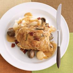 This recipe for slow-cooker chicken with bacon, mushrooms, and onions is the country version of the fussier coq au vin. Serve it with mashed potatoes.