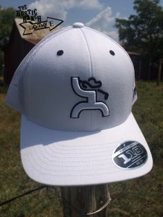 b8e1b1762b1 White trucker Features HOOey Golf Man design in white outlined in black Back  of the cap is white mesh Right side of the hat HOOey embroidered in black  White ...
