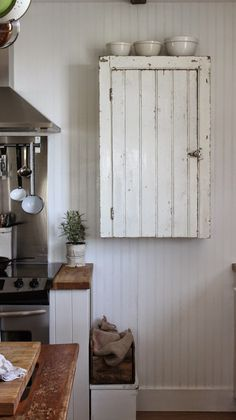 Rustic Wall Cabinet - a chippy painted vintage cupboard is modified to fit in a farmhouse kitchen - via Rustic Farmhouse: My Wall Cupboard - finally up for Mothers Day!
