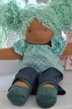 This is Jade, a Bamboletta Sitting Friend from August 19, 2013. She has dark tan skin, grey eyes, freckles, and boucle hair in Bamboletta blue.
