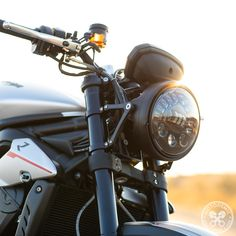 Purchase the Adaptive LED Headlight Conversion Kit by Motodemic at Motovation Accessories. Triumph Triple, Triumph Street Triple, Halogen Headlights, Led Headlights, Custom Moto, Lighting Manufacturers, Light Beam, S Models, Night Time