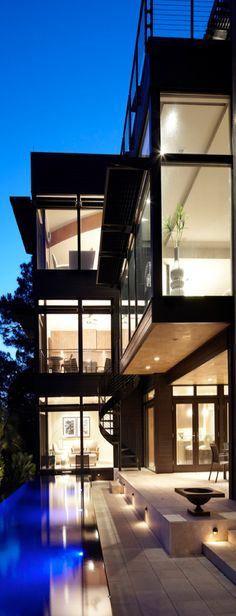 Gorgeous modern home w/pool. But with window shades that come down electronically...think The Proposal
