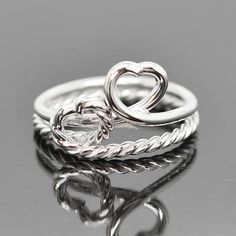 A personal favorite from my Etsy shop https://www.etsy.com/ca/listing/256455287/double-heart-infinity-ring-knot-ring