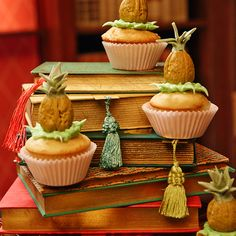 A well-read cupcake stand. Stack various-sized vintage books to create a delightful cupcake tree.