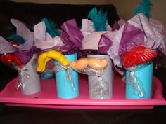 """I made """"loot bags"""" complete with mustache! Can of pop wrapped with paper, candies glue d to top and of course a feather!"""