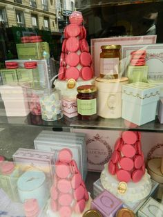 Laudree pink macarons in Paris window display.