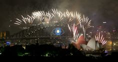 Fireworks explode over Sydney Harbour to usher in the new year, in Sydney