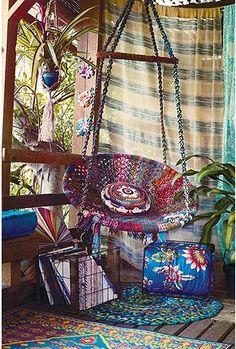 hammock chair, rugs, macramé, plants, porch