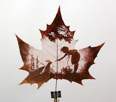 Made using tools to carefully peel off the surface of the leaf while leaving the veins intact.