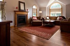 """A brand #new #hardwood #floor was #installed to replace the #carpet that was getting tired. The hardwood #product sold and installed is HomerWood 4"""" #Hickory Saddle - a rich #NewEngland favorite that adds charm and character to a #room. HomerWood is manufactured in Pennsylvania, supporting the #Amish culture for hand produced hardwood #flooring. #Finish #Wood #Design #InteriorDesign #Contractor #LivingRoom #FamilyRoom #Fireplace"""