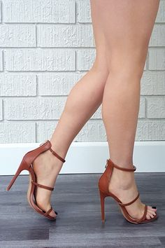 - Available in Black, Gold, Tan and White - Strappy - Open Open - Back Zipper - 4.25 inch heel