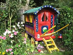 Fun Vardo - used as a playhouse and garden storage in the winter.  It's colorful and fun and at 8x4 overall, it fits in to the garden.