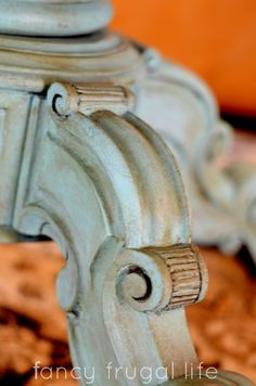 Close up of ornate legs on a vintage coffee table finished in Provence Chalk Paint® decorative paint by Annie Sloan | By Lina of Fancy Frugal Life