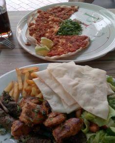 At #laikigitonia #Nicosia #Cyprus eating #lahmatzoun and #kebabs ...yummy...need to get some #koupes as well!