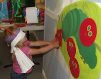 pin the head on the caterpillar game. Make caterpillar and background from felt. Attach velcro to head so it sticks when the kids press.