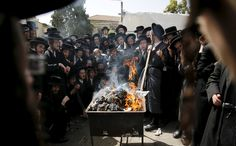 Ultra-Orthodox Jews burn leaven in the Mea Shearim neighbourhood of Jerusalem, ahead of the Jewish holiday of Passover, 2016 - by Ammar Awad (1981), Palestinian