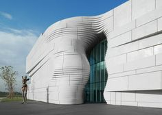 """The museum, which opened August 8, is """"rooted in local culture,"""" and was constructed with the goal of working towards building a platform of international artistic exchange with global Islamic art. The """"undulating curves and creases"""" of the building's facade were created in glass-fiber-reinforced concrete. Using parametric modelling to calculate the precise geometries of the surfaces, the architects had 1600 panels made. Every panel, ranging from the smallest at eight square meters to the…"""