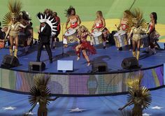 2014 FIFA World Cup closing ceremonies Colombian pop star Shakira, center in red, performs during the closing ceremony before the World Cup final soccer match between Germany and Argentina at the Maracana Stadium in Rio de Janeiro, Brazil, Sunday, July 13, 2014. (AP Photo/Themba Hadebe)