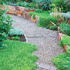 A meandering path encircles a central planting island. Crunchy pea gravel gives the path texture, and Boral bricks in Savannah Brown are designed to slow the journey.
