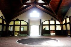 """Horses at Three Chimneys enjoy """"corner office"""" stalls with automatically refilling water buckets. The corner positioning of the stalls, in contrast to the standard construction of long rows of stalls, allows most horses to have two windows."""