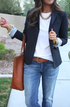Navy blazer, white tee, tan leather accessories