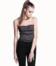 Tube top in stretch jersey with a print pattern and decorative wraparound knot at the top.