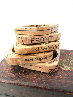 Bracelets made of wood and vintage sewing patterns