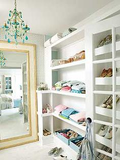Large mirror placed in a closet creates a window like feel. Lots of light.  Coastal Living