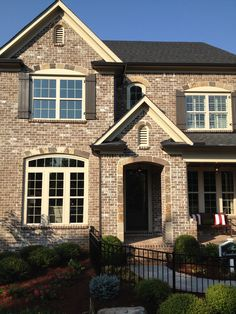 Tryon Handmade Brick beautifully juxtaposed with stone arches, trim