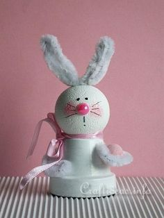 """Easter Craft for Kids- Mini Clay Pot Crafts - Clay Pot Easter Bunny...This Easter Bunny is waiting patiently for Easter to come. His first egg is ready to be given away. This project is really fun for kids. An idea would be to create a few of these and use them as place markers for Easter breakfast. Create a small paper sign with the names of the guests and insert the sign in the other """"hand""""."""