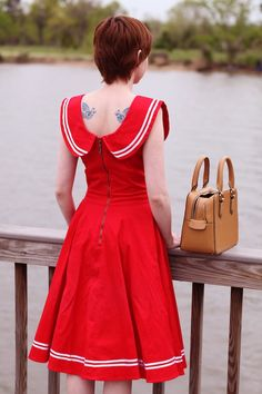 this what I would  go with this dress White necklace,no tattoo white belt shoes & bag