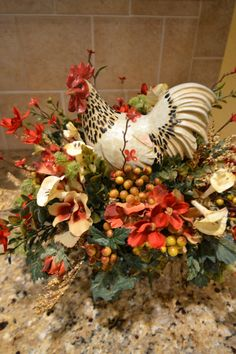 This spotted rooster arrangement would make a beautiful centerpiece all year round. It is full of rich colored flowers and berries in brick red, rust and gold. Rooster Kitchen Decor, Rooster Decor, Fall Arrangements, Silk Flower Arrangements, Tuscan Decorating, French Country Decorating, Country French, Tuscany Decor, Tuscan Design