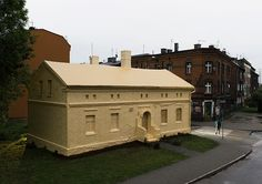 ian strange wraps historical building in poland with 600 sq meters of gold wallpaper
