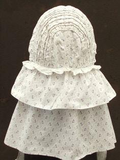 Back view of corded cotton sunbonnet.