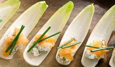 Endive with Smoked Salmon Appetizer These endive spears topped with smoked salmon, cream cheese and fresh herbs, are elegant no-bake bites that get high marks for presentation. They're ideal for cocktail parties and dinner parties and so easy-to-assemble, you can add it to any brunch or buffet table too.