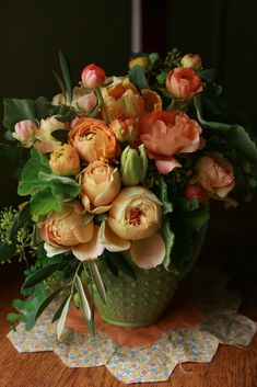 So beautiful it almost looks like a painting. Peach ranunculus, scented geraniums, roses and parrot tulips.