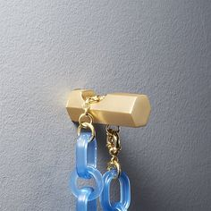 Hang in there. Notched wall hook hangs minimal in solid brass. Anchor in the entry to hold coats, scarves, bags and pet leashes, or arrange multiples for DIY string art. -Brass -Hook holds up to 12 lbs -Wipe with a damp cloth -Made in India White Wall Shelves, Gold Shelves, Modern Wall Decor, Metal Wall Decor, Wall Mounted Shelves, Wall Hooks, Wood Bike, Leather Wall, Entryway Storage