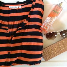 Orange striped blouse Soft and flowy! It's an orange and dark blue striped blouse. It buttons partway down the chest. Pockets on both sides of the chest. The sleeves are about elbow length. 100% rayon. St. John's Bay Tops Blouses