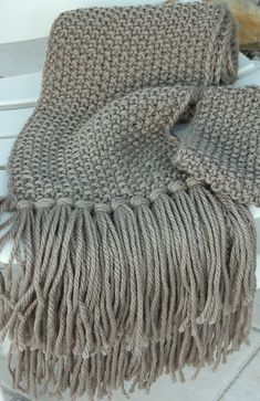 My favorite stitch for a hand-knit scarf. Simple seed stitch-so supple, so cozy.  Free pattern here.