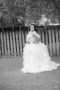 The bride in her wedding dress. This bride wanted photos of her in her wedding dress before her wedding to have as a keepsake.