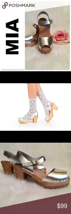Mia Silver Greta Clogs Metallic Mia Greta clogs. Sold out on almost all websites! Gorgeous, on-trend, and comfortable. Lug soles for added style. Mia Shoes Mules & Clogs