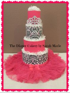 4 tier Tutu Diaper Cake! Perfect gift/centerpiece for baby shower! Check out my FB page https://www.facebook.com/diapercakerybysarahmarie #diaper cake #damask print #cute #4 tier cake #tutu diaper cake #100% usable